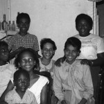 Principal's wife Marion Alleyne with students.